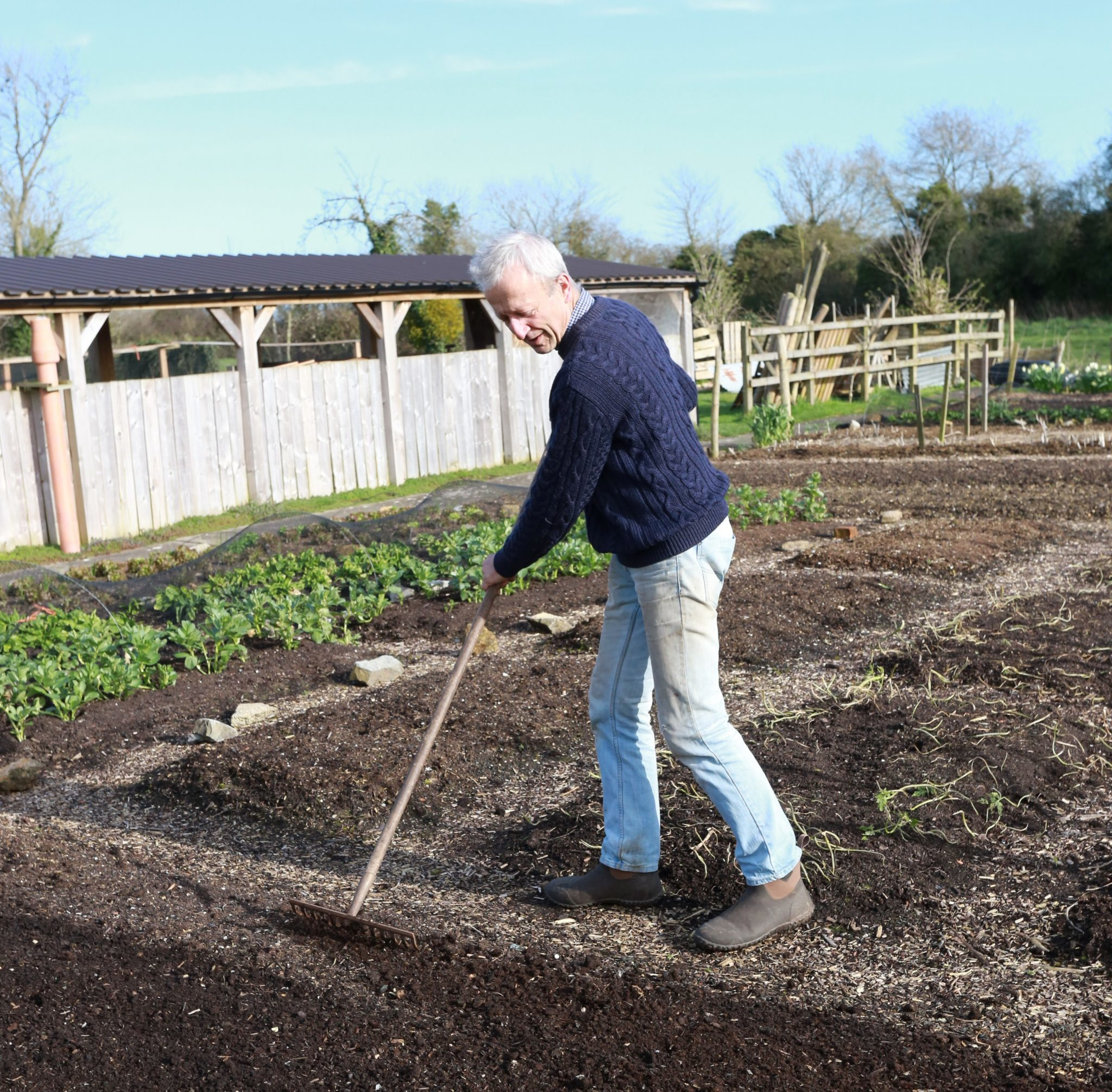 Charles Dowding lightly raking surface compost in early spring to level surface and reduce weeding later on 1 2048x2012