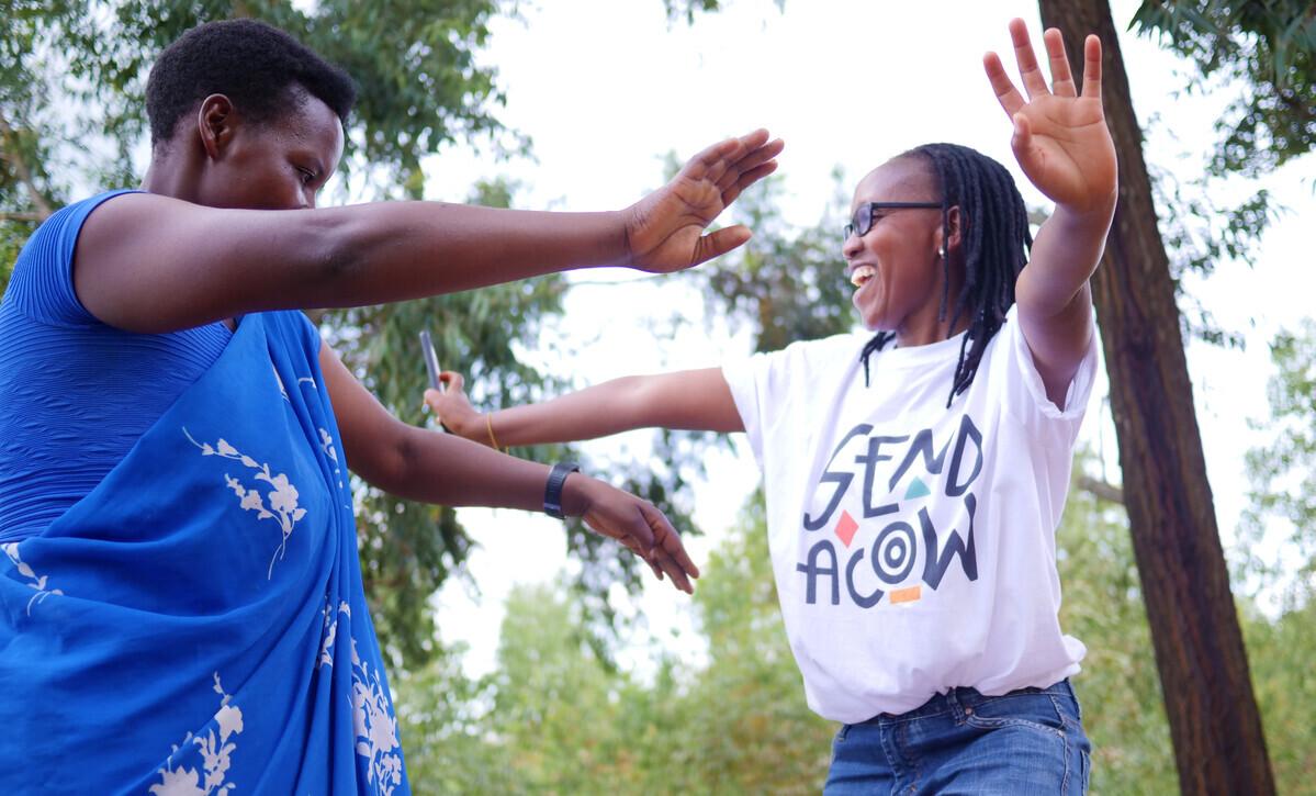 Rwanda staff members reaching out to hug each other
