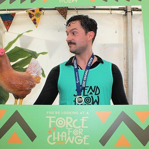 Ben Aldridge after running the Bath Half holding a prop chicken
