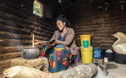 Fuel saving stove being used to cook a pot of food The stove uses less fuel so saves time collecting wood for families
