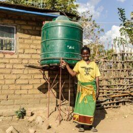 Lontia Lungu and her rainwater tank